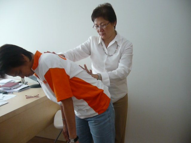 Sifu Connie treating patient with slipped disc